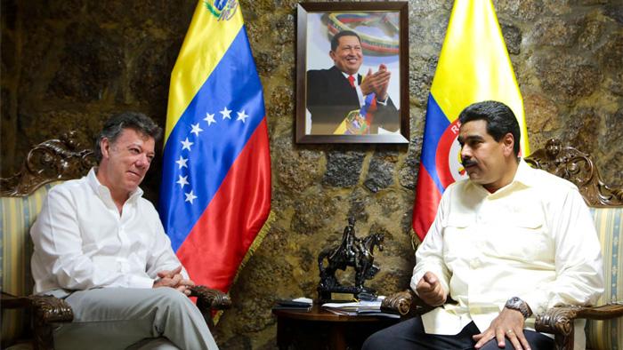 Presidente Juan Manuel Santos, junto a Nicolás Maduro
